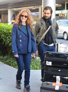 th_08232_Tikipeter_Jessica_Chastain_arrives_into_LAX_009_122_24lo.jpg